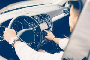 Man uses automotive navigation system